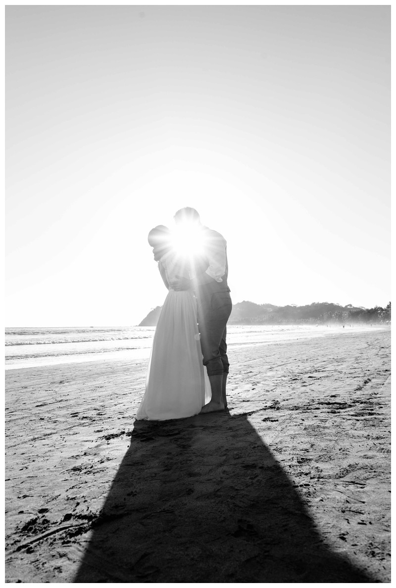 Bride and groom laughing on the beach during golden hour after their beach elopement in Samara Costa Rica. Photographed by Kristen M. Brown, Samba to the Sea Photography.