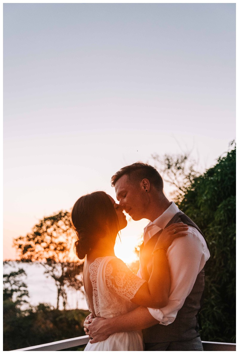 Bride and groom kissing at sunset after their beach elopement in Samara Costa Rica. Photographed by Kristen M. Brown, Samba to the Sea Photography.