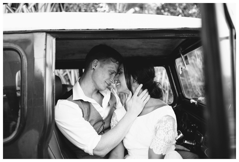Bride and groom sitting in a Toyota Land Cruise J40 after their beach elopement in Samara Costa Rica. Photographed by Kristen M. Brown, Samba to the Sea Photography.