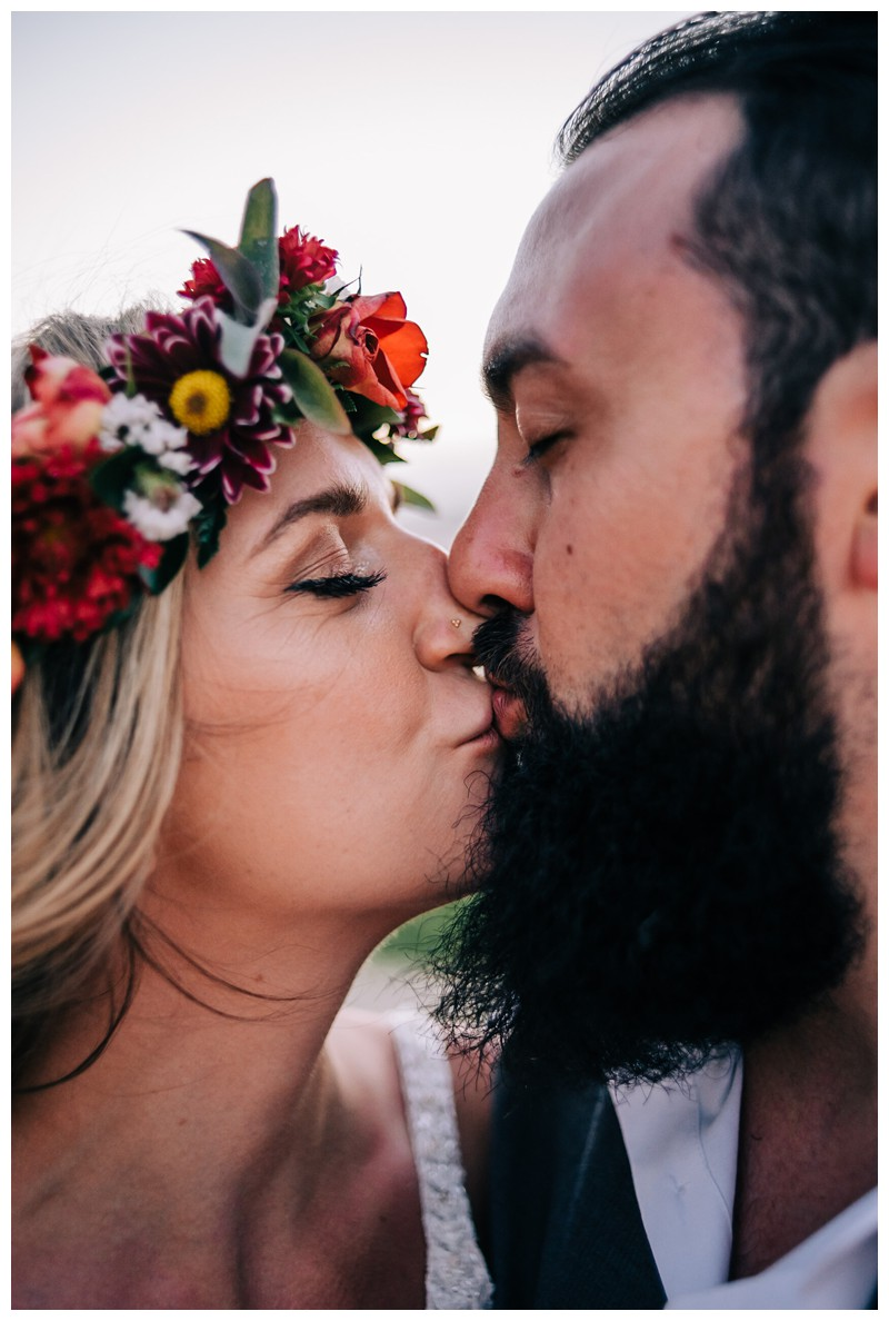 Bride and groom kissing on the beach after their Costa Rica elopement. Elope to Tamarindo Costa Rica. Photographed by Kristen M. Brown, Samba to the Sea Photography.