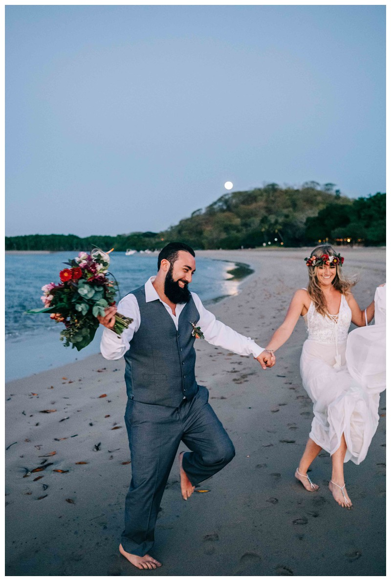 Bride and groom dancing on the beach after their Costa Rica elopement. Elope to Tamarindo Costa Rica. Photographed by Kristen M. Brown, Samba to the Sea Photography.