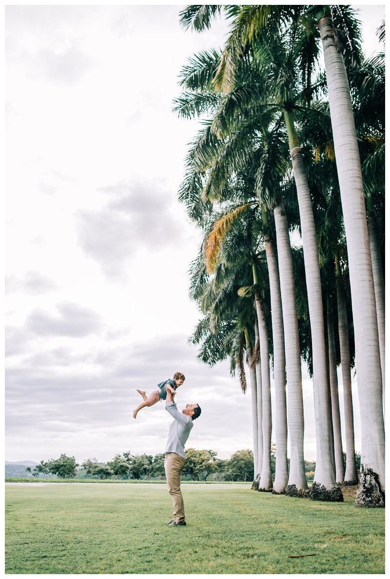 Dad throwing his son in the air during family Photos at the Andaz Costa Rica. Photographed by Kristen M. Brown, Samba to the Sea Photography.