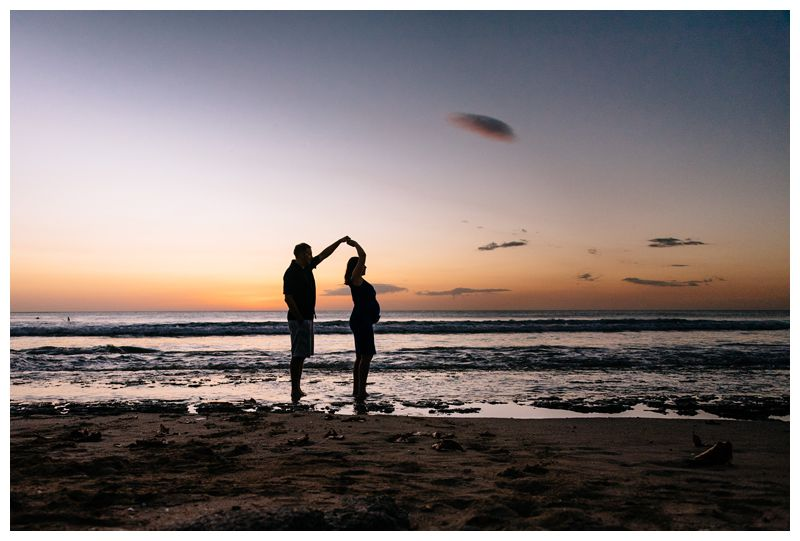 Husband and wife on the beach during sunset for maternity family phots in Playa Avellanas Costa Rica. Photographed by Kristen M. Brown, Samba to the Sea Photography.