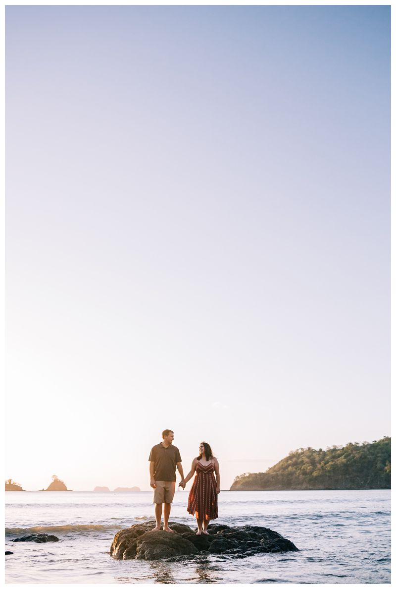 Husband and wife enjoying the beach in Costa Rica during anniversary photos. Photographer in Las Catalinas Costa Rica. Photographed by Kristen M. Brown, Samba to the Sea Photography.