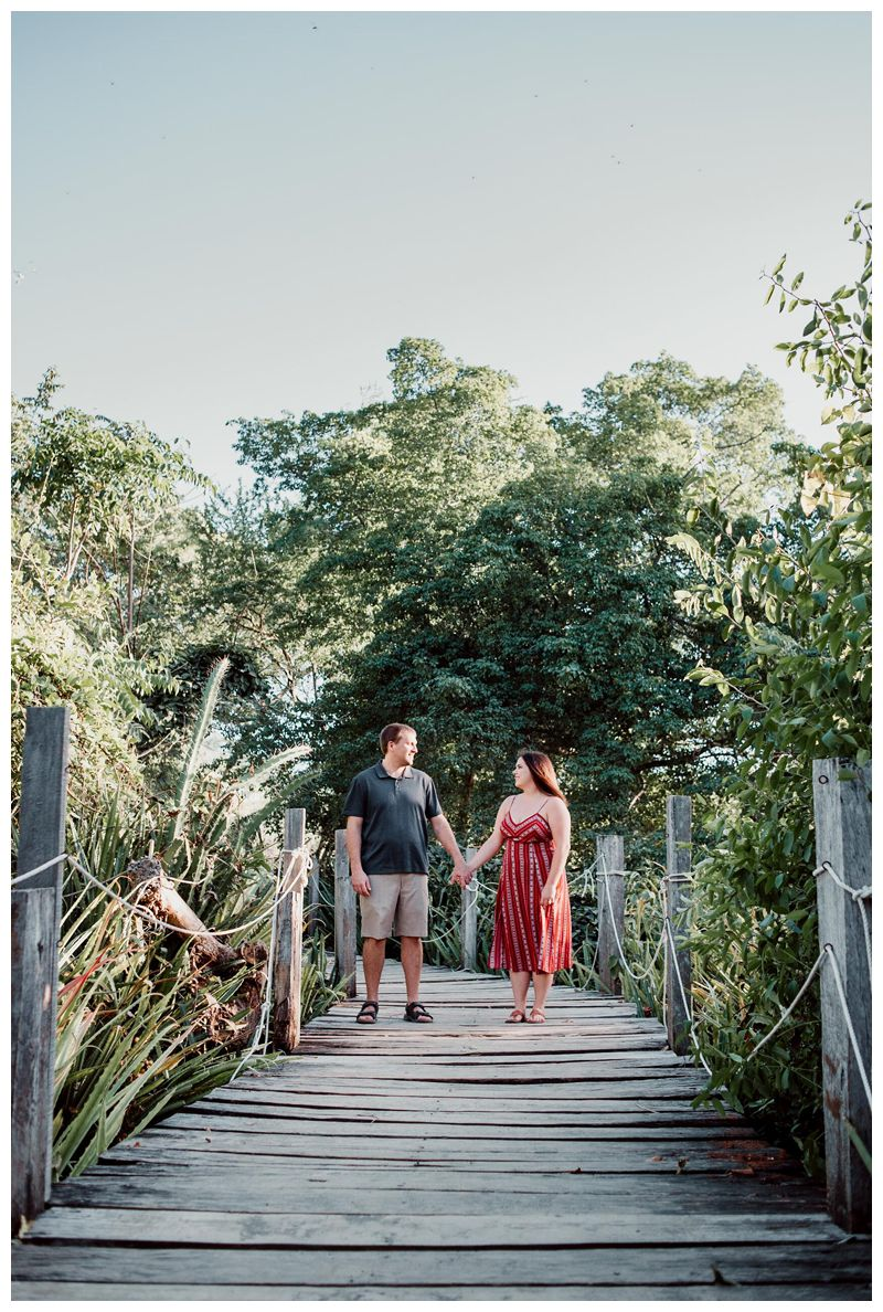 Couple laughing during anniversary photos. Photographer in Las Catalinas Costa Rica. Photographed by Kristen M. Brown, Samba to the Sea Photography.