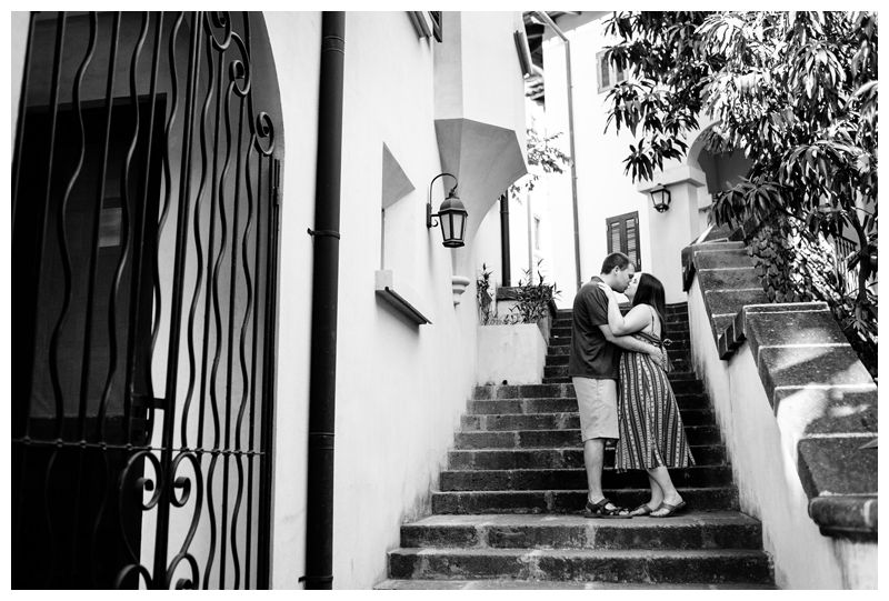 Couple kissing on the stairs in beautiful Las Catalinas Costa Rica. Photographer in Las Catalinas Costa Rica. Photographed by Kristen M. Brown, Samba to the Sea Photography.