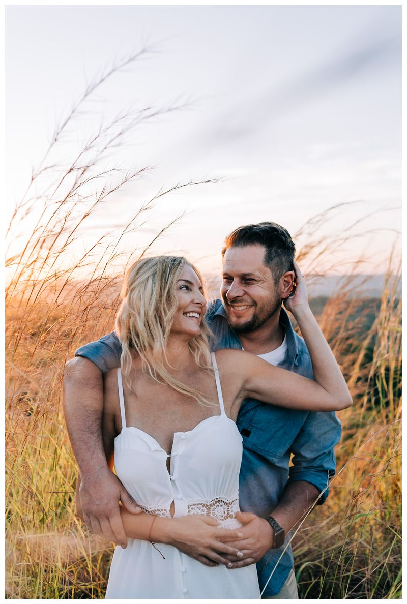 Couple laughing during sunrise engagement photos in Tamarindo Costa Rica. Photographed by Kristen M. Brown, Samba to the Sea Photography.