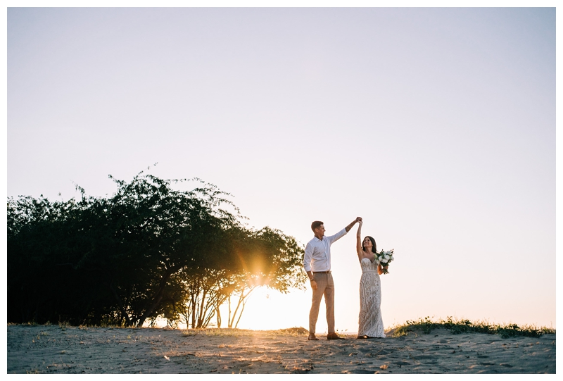Couple dancing on the beach at sunset after their Tamarindo Costa Rica Elopement at Pangas Beach Club. Photographed by Kristen M. Brown, Samba to the Sea Photography.