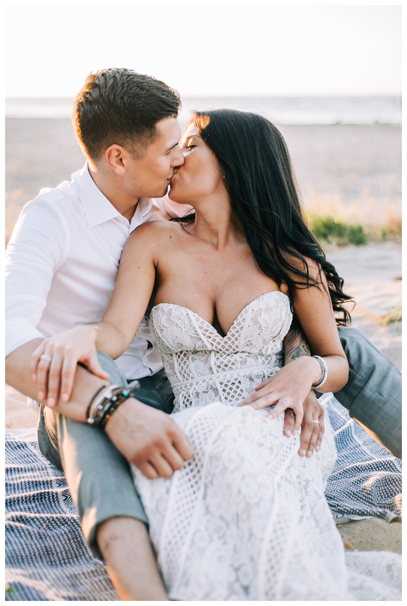 Couple kissing on the beach at sunset after their Tamarindo Costa Rica Elopement at Pangas Beach Club. Photographed by Kristen M. Brown, Samba to the Sea Photography.