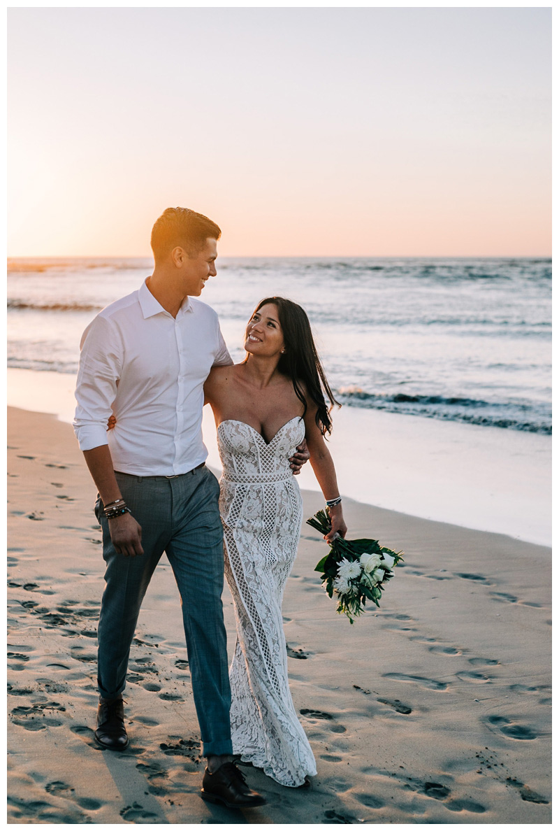 Couple walking on the beach at sunset after their Tamarindo Costa Rica Elopement at Pangas Beach Club. Photographed by Kristen M. Brown, Samba to the Sea Photography.