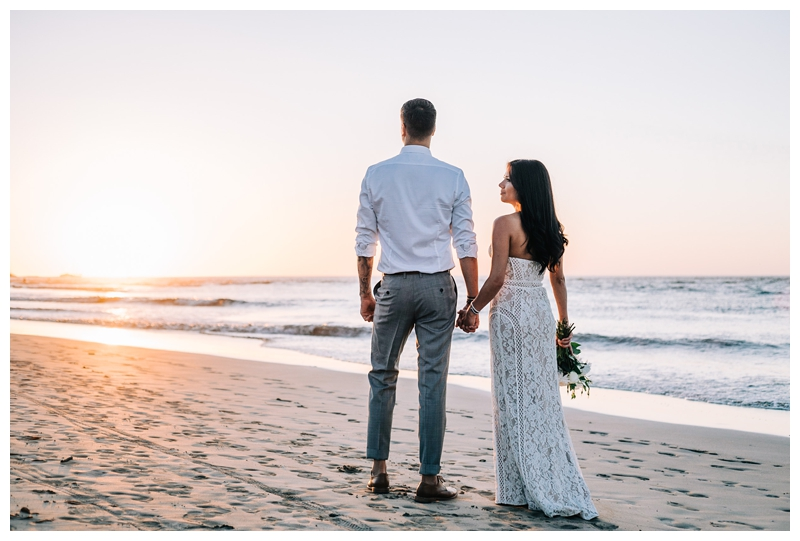 Couple on the beach at sunset after their Tamarindo Costa Rica Elopement at Pangas Beach Club. Photographed by Kristen M. Brown, Samba to the Sea Photography.