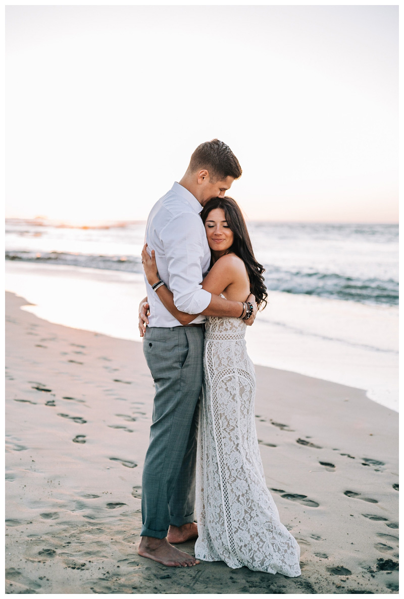 Couple embracing on the beach at sunset after their Tamarindo Costa Rica Elopement at Pangas Beach Club. Photographed by Kristen M. Brown, Samba to the Sea Photography.
