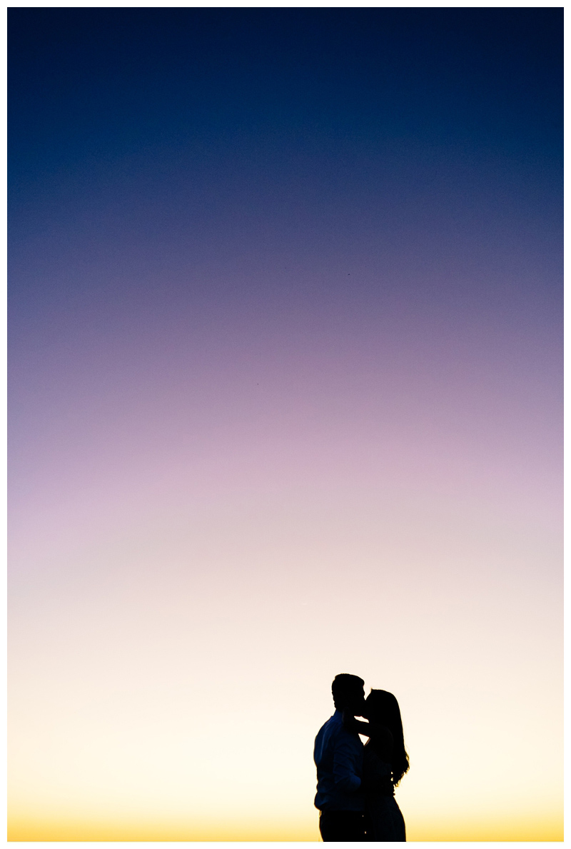 Couple kissing at sunset after their Tamarindo Costa Rica Elopement at Pangas Beach Club. Photographed by Kristen M. Brown, Samba to the Sea Photography.