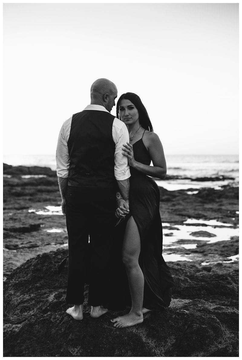 Husband and wife on the beach during sunset during their tropical anniversary photos in Tamarindo Costa Rica. Photographed by Kristen M. Brown, Samba to the Sea Photography.