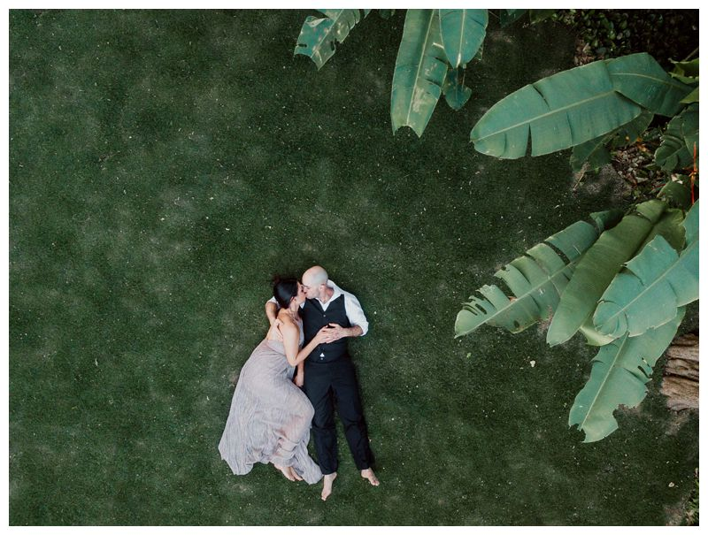 Aerial image of couple in the beautiful tropical gardens at Hotel Capitan Suizo during their tropical anniversary photos in Tamarindo Costa Rica. Photographed by Kristen M. Brown, Samba to the Sea Photography.