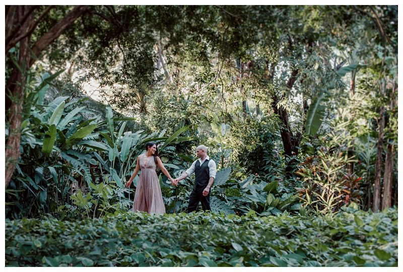 Couple walking through the beautiful tropical gardens at Hotel Capitan Suizo during their tropical anniversary photos in Tamarindo Costa Rica. Photographed by Kristen M. Brown, Samba to the Sea Photography.
