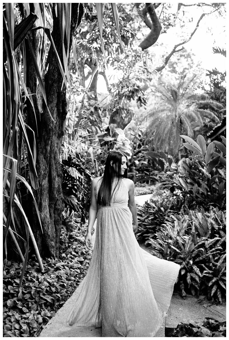 Woman in the beautiful tropical gardens at Hotel Capitan Suizo during their tropical anniversary photos in Tamarindo Costa Rica. Photographed by Kristen M. Brown, Samba to the Sea Photography.