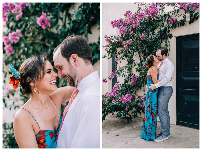Bride and groom kissing in front a magenta Bougainvillea after their tropical wedding in Costa Rica. Photographed by Kristen M. Brown, Samba to the Sea Photography.