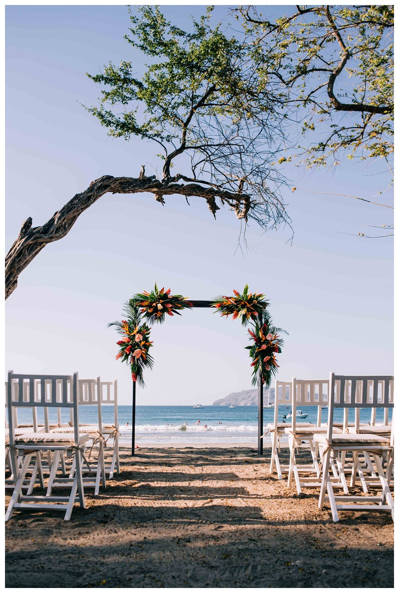 Tropical wedding alter with details with Mostera leaf, birds of paradise flower, and anthurium (Hawaiian Heart) florals. Tropical wedding in Tamarindo Costa Rica. Photographed by Kristen M. Brown, Samba to the Sea Photography.