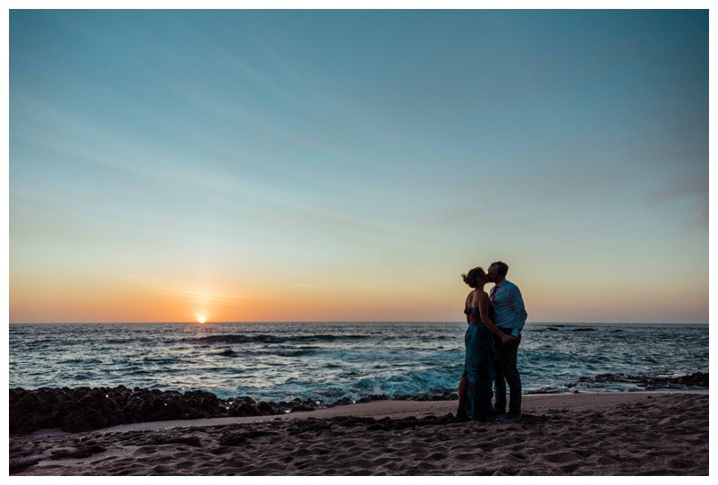 Bride and groom kissing on the beach during sunset in Costa Rica. Photographed by Kristen M. Brown, Samba to the Sea Photography.
