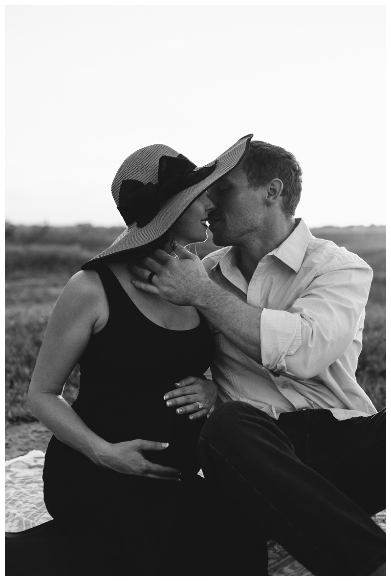 Couple kissing on the beach during beach maternity photos in Tamarindo Costa Rica. Photographed by Kristen M. Brown, Samba to the Sea Photography.