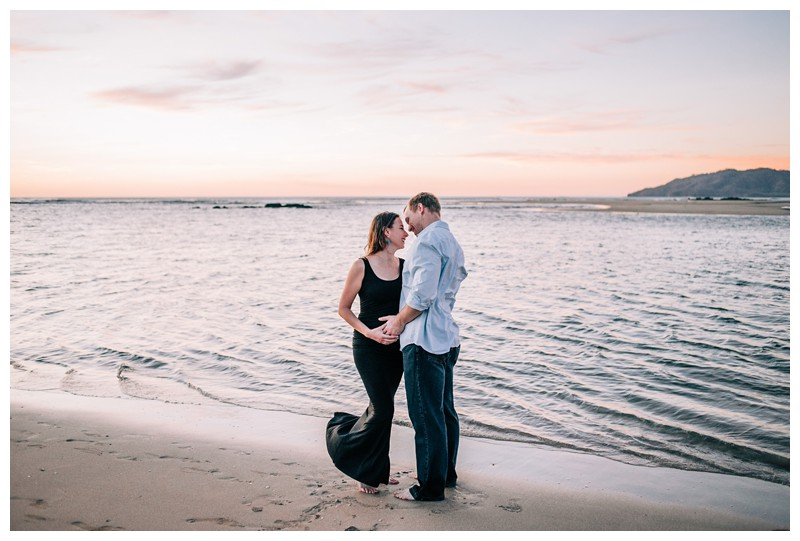 Couple enjoying the afternoon during beach maternity photos in Tamarindo Costa Rica. Photographed by Kristen M. Brown, Samba to the Sea Photography.