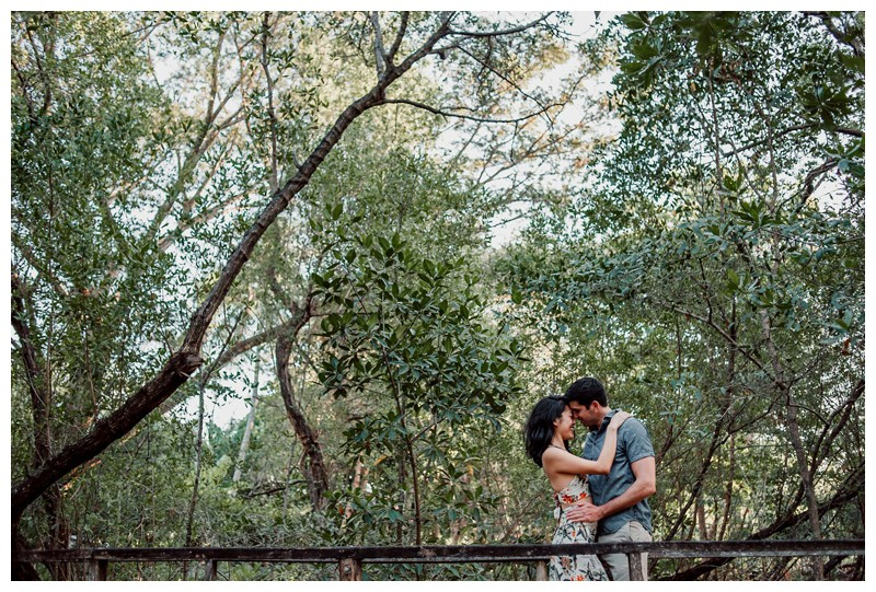 Couple kissing in a tropical beach path after beach proposal in Tamarindo Costa Rica. Photographed by Kristen M. Brown, Samba to the Sea Photography.