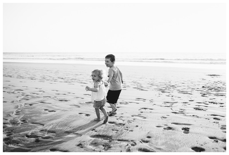Brother and sister running on the beach during family photos in Playa Avellanas Costa Rica. Photographed by Kristen M. Brown, Samba to the Sea Photography.