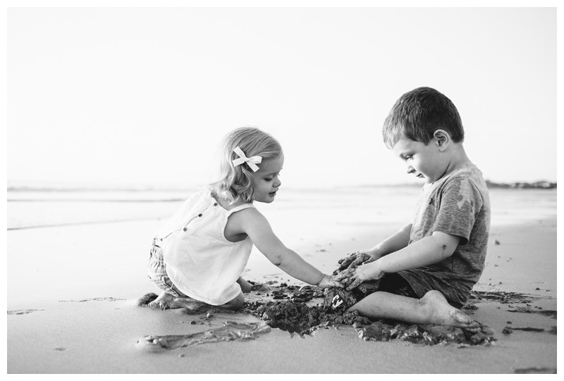 Brother and sister playing in the sand on the beach during family photos in Playa Avellanas Costa Rica. Photographed by Kristen M. Brown, Samba to the Sea Photography.