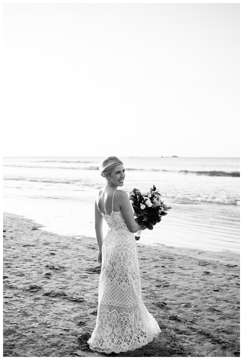 Bridal portrait on the beach. Destination beach wedding in Tamarindo Costa Rica. Photographed by Kristen M. Brown, Samba to the Sea Photography.