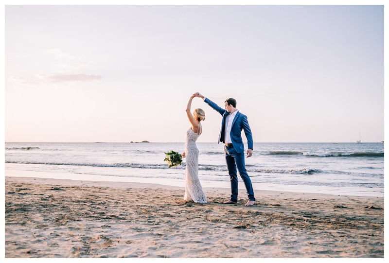 Bride and groom dancing on the beach after their destination beach wedding in Tamarindo Costa Rica. Photographed by Kristen M. Brown, Samba to the Sea Photography.