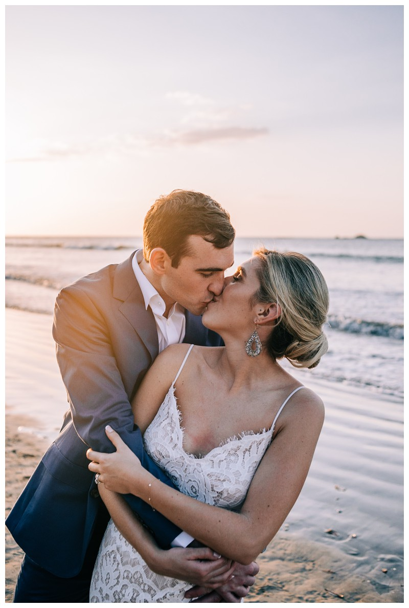 Bride and groom kissing on the beach after their destination beach wedding in Tamarindo Costa Rica. Photographed by Kristen M. Brown, Samba to the Sea Photography.