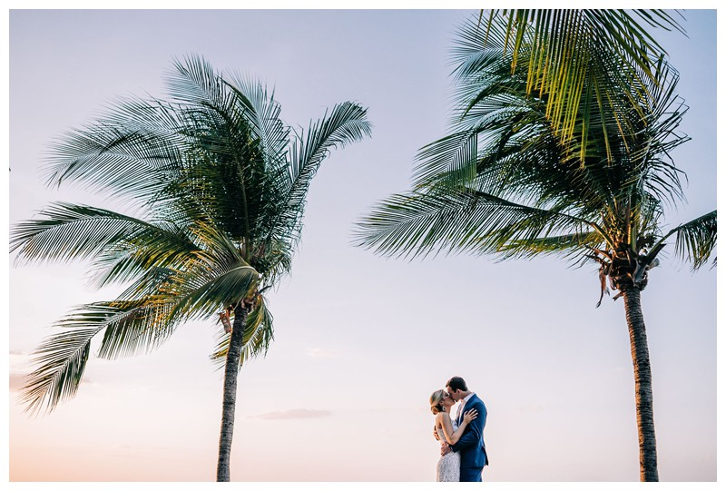 Bride and groom kissing under palm trees on the beach after their destination beach wedding in Tamarindo Costa Rica. Photographed by Kristen M. Brown, Samba to the Sea Photography.