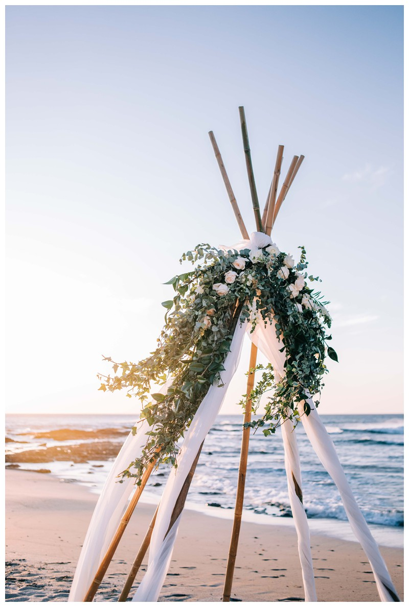 Tee pee floral alter on the beach. Elegant boho elopement in Costa Rica on the beach in Playa Langosta. Photographed by Kristen M. Brown, Samba to the Sea Photography.