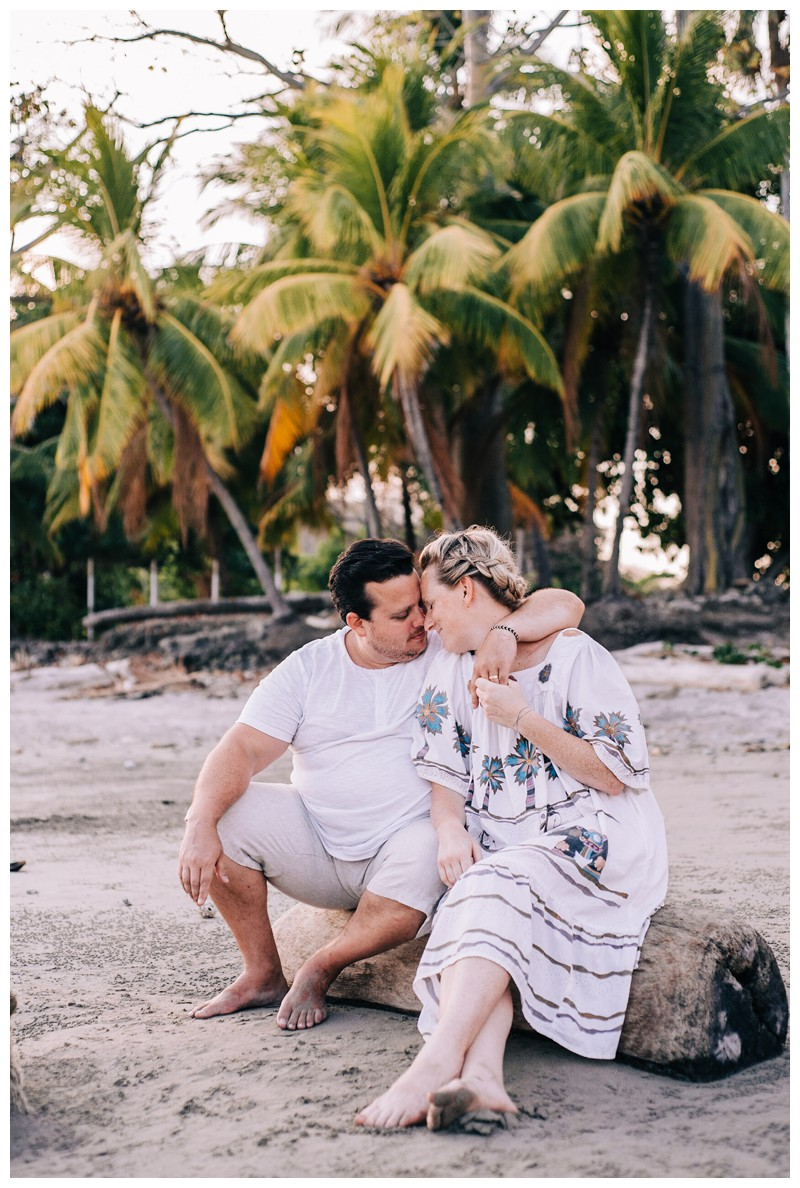 Mom and dad on the beach during family photos in Playa Guiones Costa Rica. Photographed by Kristen M. Brown, Samba to the Sea Photography.