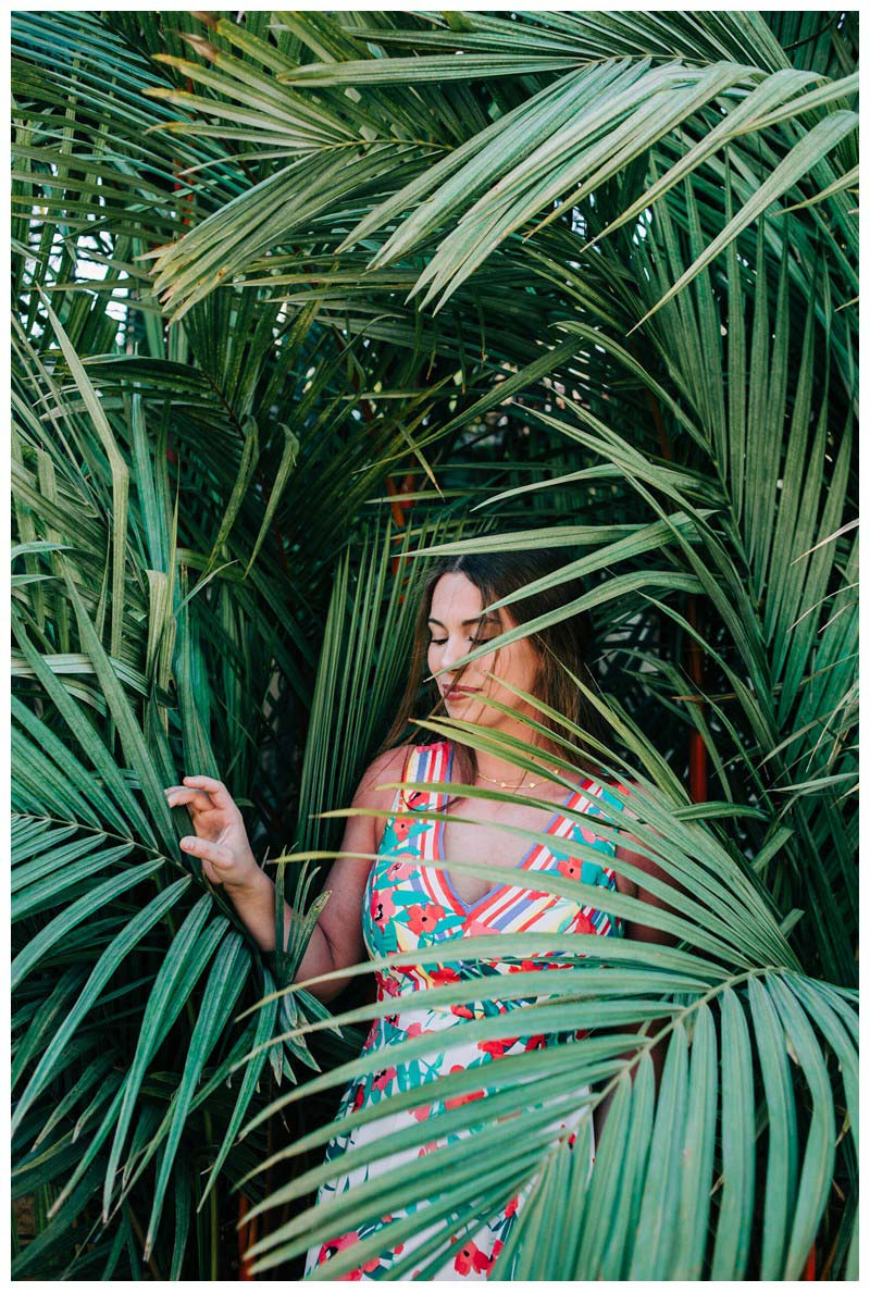 Young woman and palm trees. Senior year lifestyle photos in Playa Flamingo Costa Rica. Photographed by Kristen M. Brown, Samba to the Sea Photography.