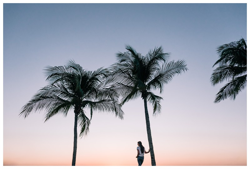 Young woman walking under palm trees during sunset in Costa Rica. Senior year lifestyle photos in Playa Flamingo Costa Rica. Photographed by Kristen M. Brown, Samba to the Sea Photography.