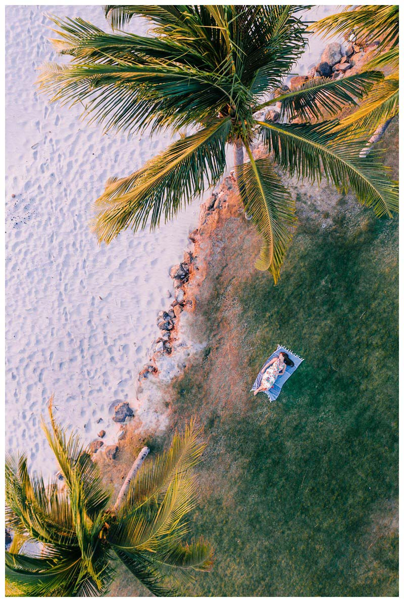 Aerial image of young woman under palm trees in Costa Rica. Senior year lifestyle photos in Playa Flamingo Costa Rica. Photographed by Kristen M. Brown, Samba to the Sea Photography.
