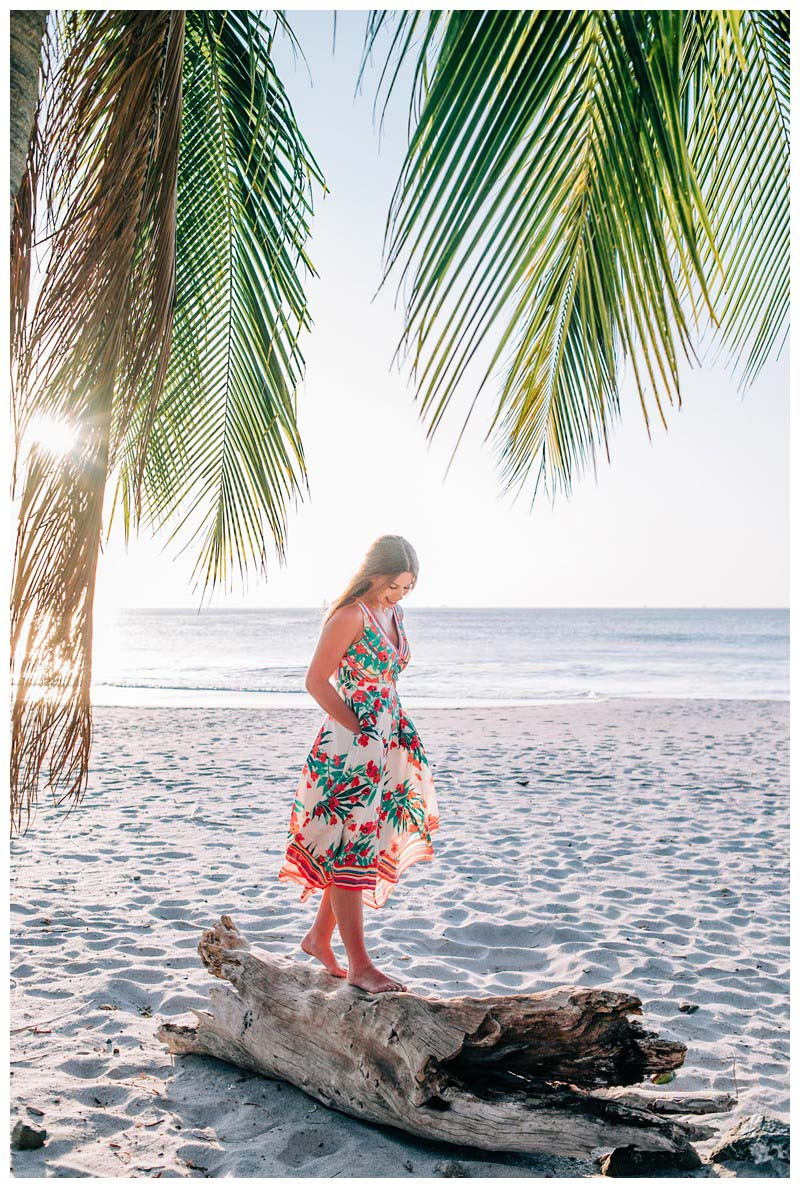 Young woman walking on a piece of driftwood on the beach. Senior year lifestyle photos in Playa Flamingo Costa Rica. Photographed by Kristen M. Brown, Samba to the Sea Photography.