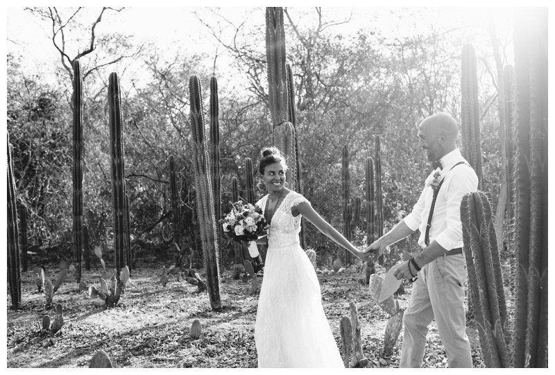 Bride and groom walking through cacti garden. Wedding at La Senda Labyrinth in Costa Rica. Photographed by Kristen M. Brown, Samba to the Sea Photography.