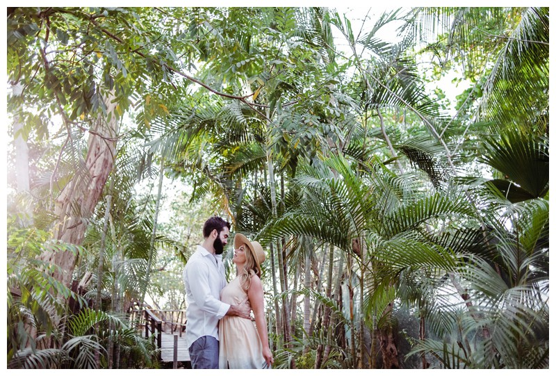 Husband and wife exploring a beach path with palm trees in Costa Rica. Photographed by Kristen M. Brown, Samba to the Sea Photography.