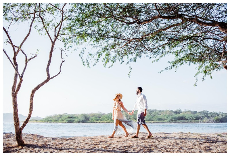 Husband and wife walking on the beach in Tamarindo Costa Rica. Photographed by Kristen M. Brown, Samba to the Sea Photography.