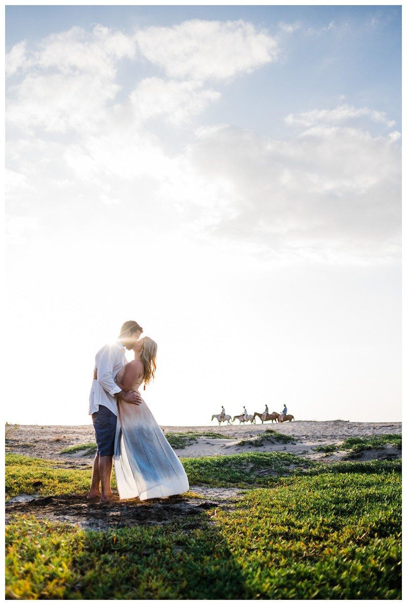Husband and wife kissing on the beach in Tamarindo Costa Rica. Photographed by Kristen M. Brown, Samba to the Sea Photography.