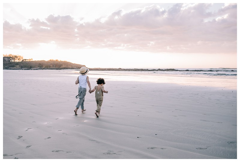Brothers running on the beach during sunset in Tamarindo Costa Rica. Family photos at Hotel Capitan Suizo in Tamarindo Costa Rica. Photographed by Kristen M. Brown, Samba to the Sea Photography.
