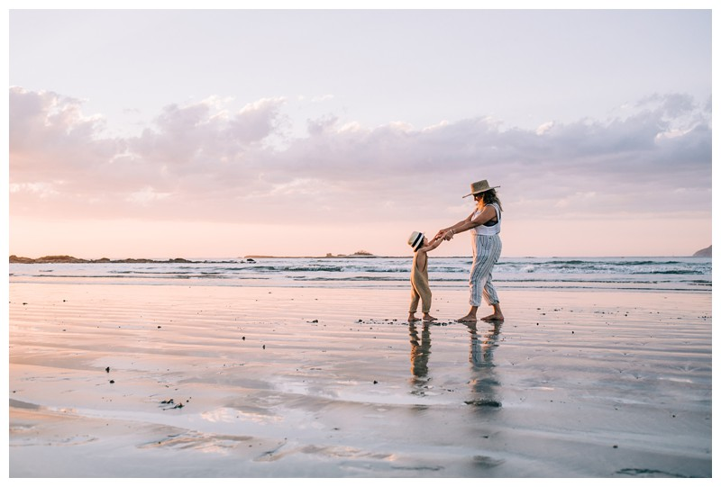 Mom and her son walking on the beach during sunset in Tamarindo Costa Rica. Family photos at Hotel Capitan Suizo in Tamarindo Costa Rica. Photographed by Kristen M. Brown, Samba to the Sea Photography.
