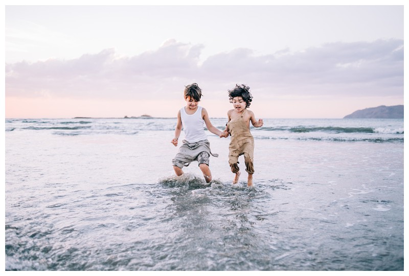 Brothers jumping in the ocean during sunset in Tamarindo Costa Rica. Family photos at Hotel Capitan Suizo in Tamarindo Costa Rica. Photographed by Kristen M. Brown, Samba to the Sea Photography.