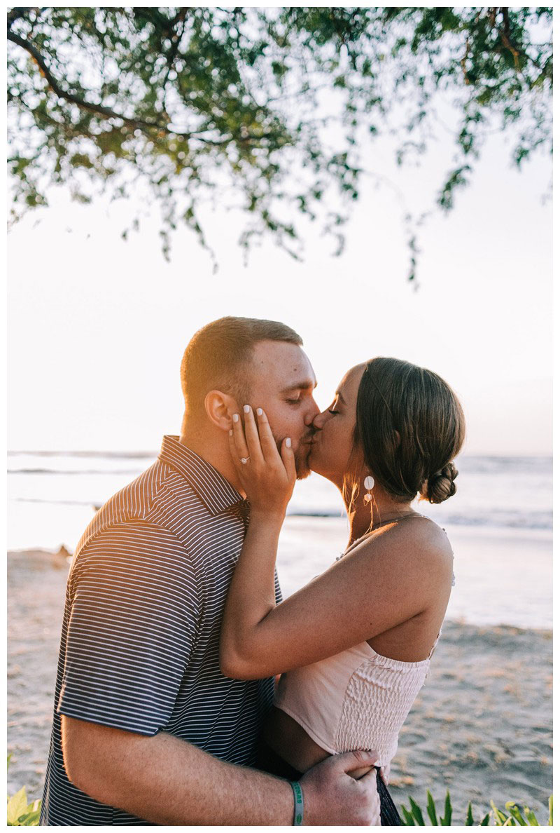 Couple kissing on the beach after a golden hour beach proposal in Tamarindo Costa Rica. Photographed by Kristen M. Brown, Samba to the Sea Photography.