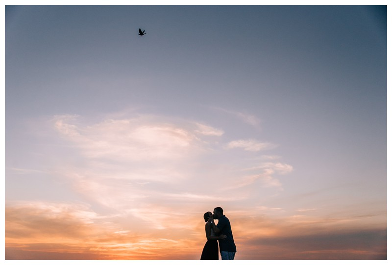 Couple kissing on the beach during sunset after a golden hour beach proposal in Tamarindo Costa Rica. Photographed by Kristen M. Brown, Samba to the Sea Photography.