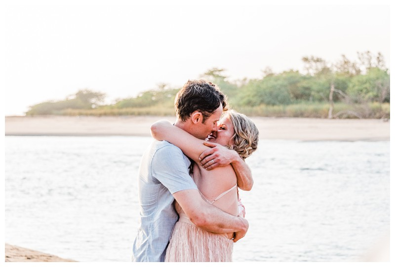 Bride and groom kissing on the beach. Intimate destination beach wedding in Costa Rica. Photographed by Kristen M. Brown, Samba to the Sea Photography.