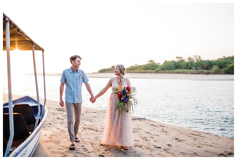Bride and groom walking on the beach in Tamarindo Costa Rica during golden hour. Intimate destination beach wedding in Costa Rica. Photographed by Kristen M. Brown, Samba to the Sea Photography.